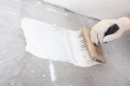 Mans hand with brush during linoleum flooring Reklamní fotografie