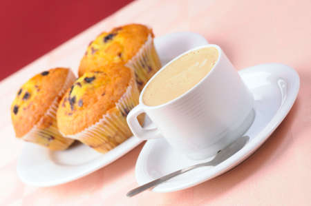 Cup of coffee and three muffins Stock Photo - 4595066