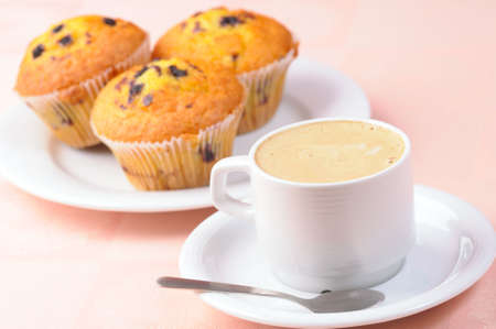 Cup of coffee and three muffins Stock Photo - 4595067