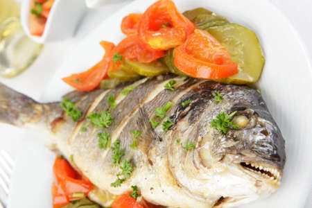 Roasted gilt-head sea bream with vegetables and white wine Stock Photo - 4595235