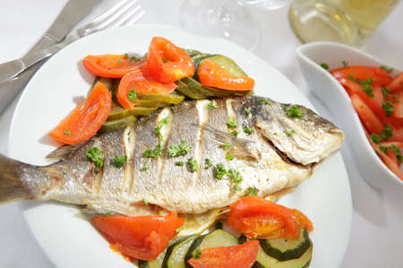 Roasted gilt-head sea bream with vegetables and white wine Stock Photo - 4595174