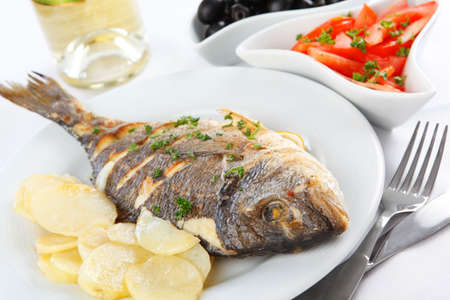 Roasted gilt-head sea bream with vegetables and white wine Stock Photo - 4595252