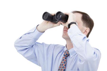 Businessman with binoculars isolated on white background Stock Photo - 4733630