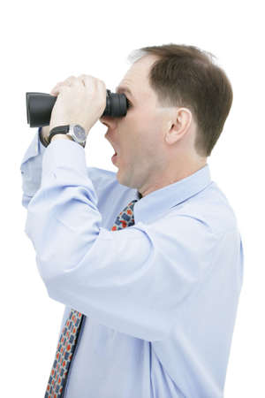 Surprised businessman with binoculars isolated on white background Stock Photo - 4733632