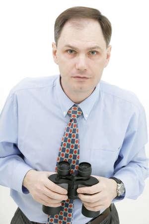Businessman with binoculars isolated on white background Stock Photo - 4733634