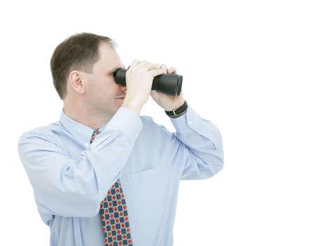 Businessman with binoculars isolated on white background Stock Photo - 4733647