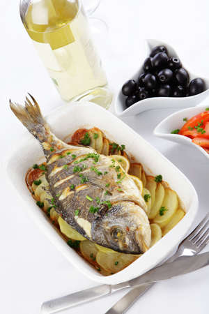 Baked gilt-head sea bream with vegetables and white wine photo