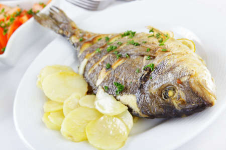 Roasted gilt-head sea bream with vegetables photo