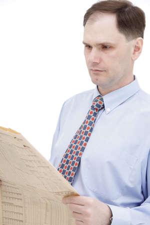Businessman reading newspaper isolated on white background photo