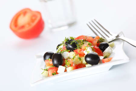 Greek salad on white background photo