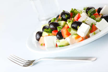 Greek salad on white background photo