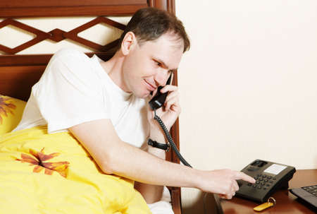 Man in hotel calling to service Stock Photo - 4788090