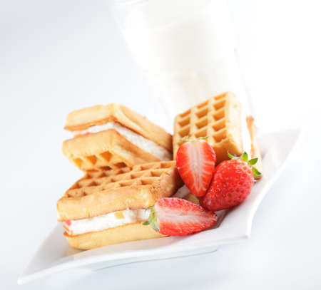Breakfast with belgian waffles, milk and strawberry photo