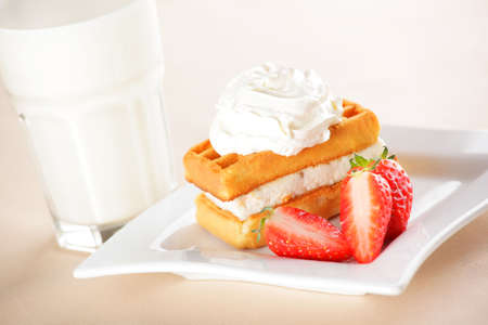 Breakfast with belgian waffles, milk and strawberry Stock Photo - 4794156