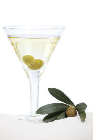 Martini with olives on white beach sand photo