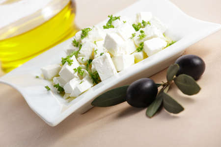 feta cheese with olive branch photo