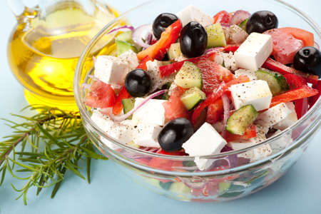 Greek salad served with olive oils