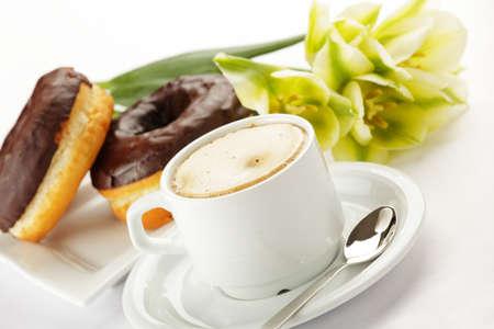 Chocolate donuts with coffee