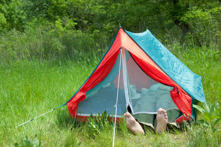 Resting in tent on a green grass photo