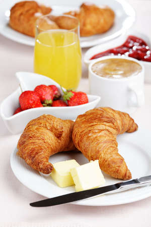 croissants: French breakfast with croissant, coffee, strawberry, and juice