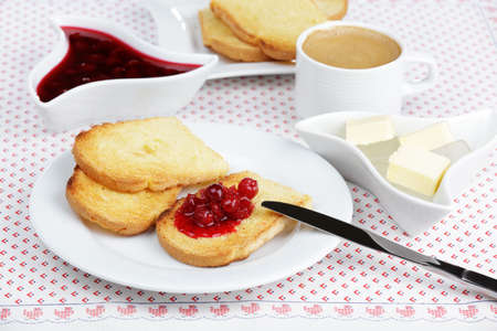 Breakfast with toasts, sour cherry jam, butter, and coffee photo