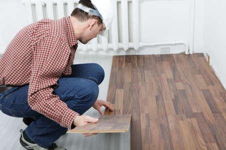 underlay: Man making the laminate flooring installation