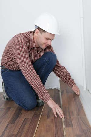 Man making the laminate flooring installation