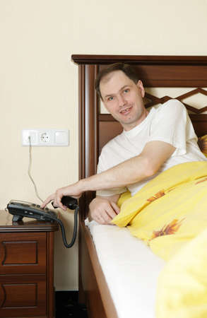 Man in hotel calling to service Stock Photo - 5500599