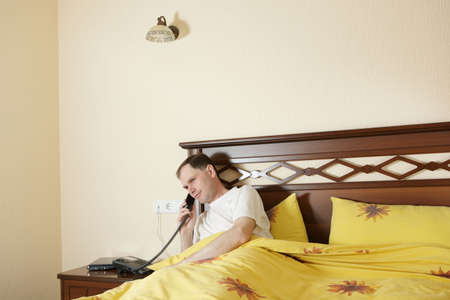 Man in hotel calling to service Stock Photo - 5500605