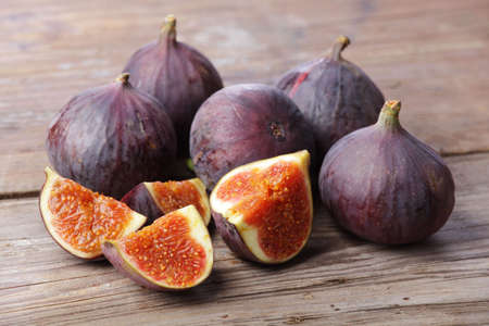 perishable: Figs on wooden rustic background