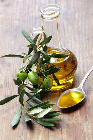 Olive oil with olive branch