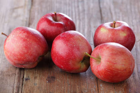 Red apples on a wooden table Stock Photo - 5659329