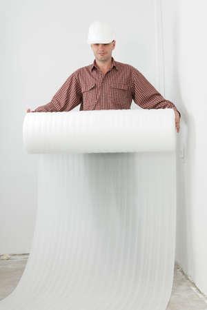 foaming: Man making the laminate flooring installation