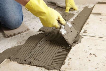 redesign: Man making the ceramic tile flooring Stock Photo