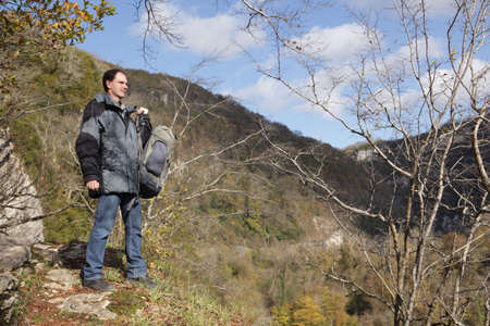 Hiker with backpack in autumn mountains Stock Photo - 6106804
