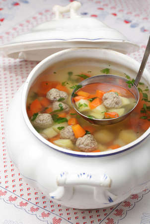 ladles: Vegetable soup with meatballs in a tureen Stock Photo