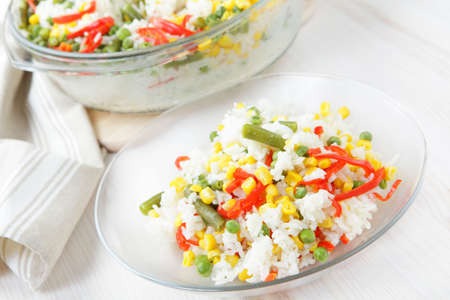 Rice with green peas, corn, runner bean, and red pepper photo