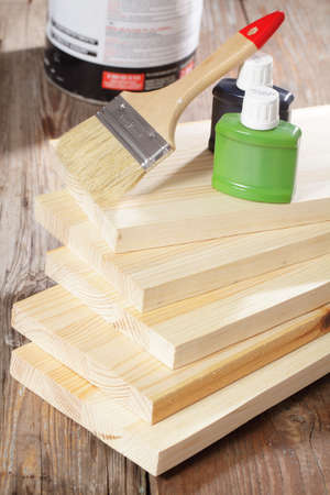 redesign: Brush and paints on stack of wooden planks Stock Photo