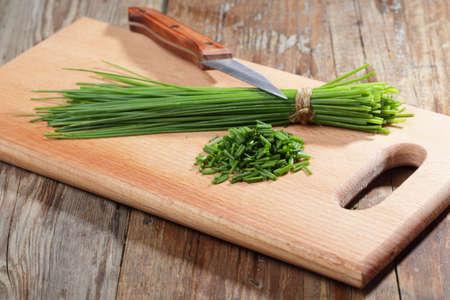 sheaf: Sheaf of chives and a knife on a cutting board