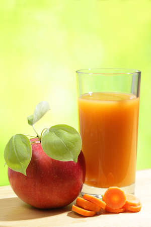 organic drinks: Apple, sliced carrot, and a glass of juice Stock Photo