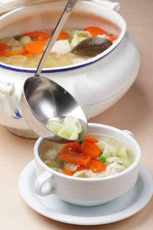 Chicken soup in a tureen photo