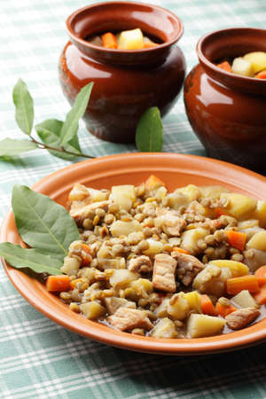 чечевица: Lentil stew in plate and pots