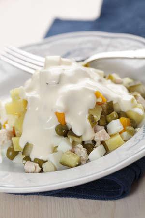 huzarensalade: Russian salad in white plate closeup
