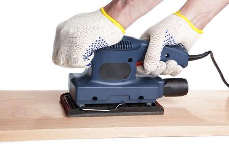 sander: Sanding the beech plank with finishing sander Stock Photo