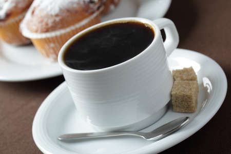 Cup of black coffee against muffins Stock Photo - 8158410