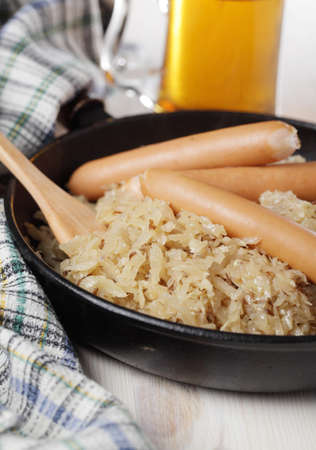 Sausages and Bavarian kraut with caraway photo