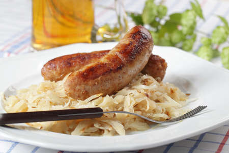 Roasted sausage with braised cabbage and beer photo