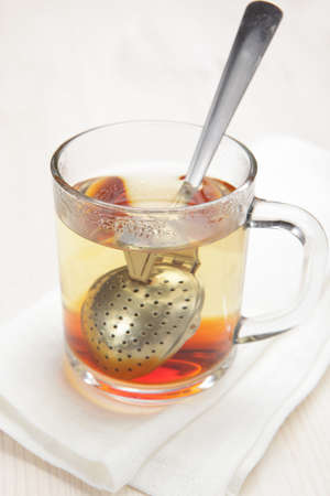 infuser: Making black tea using tea infuser spoon  Stock Photo