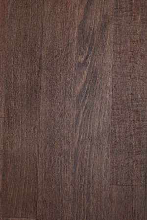 Texture of beech wood toned by dark walnut wood stain photo