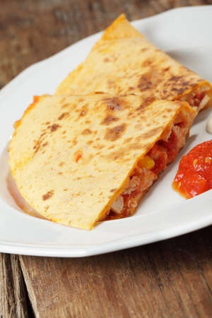 chicken meat: Quesadilla with chicken meat, corn, and cheese served with salsa and sour cream